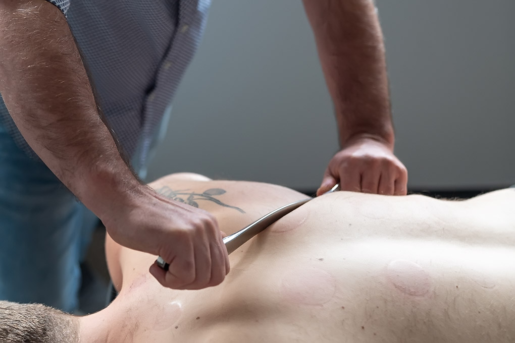 stroking motion applied to the scapula with a tool