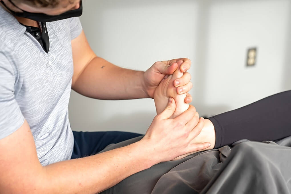 Reflexology applied with pressure to the bottom of the foot