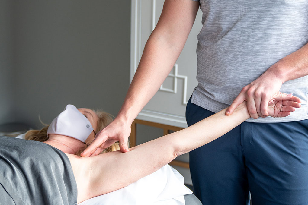 Trigger Point Therapy with pressure applied to shoulder